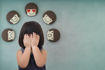 Asian child girl with green concrete wall background, Feelings and emotions of kid