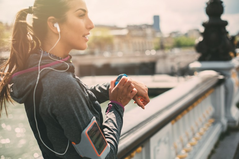 Runner using smart watch