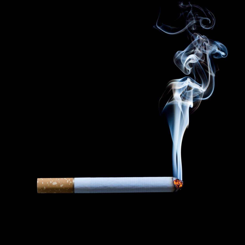 smoking cigarette on black background